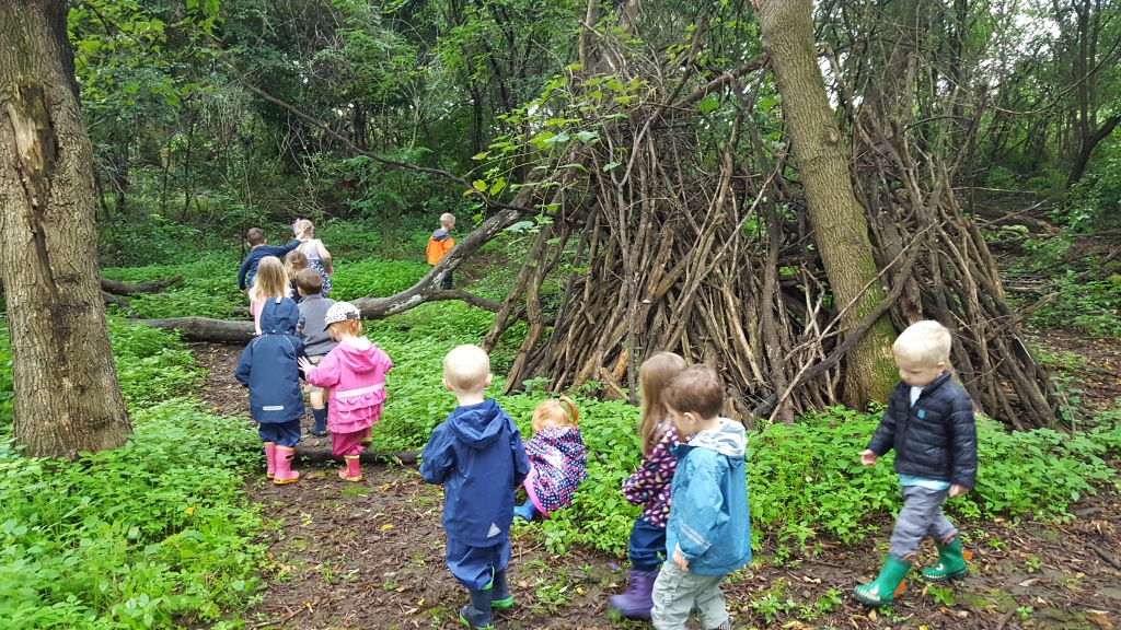 Children exploring as a group in an unfamiliar environment